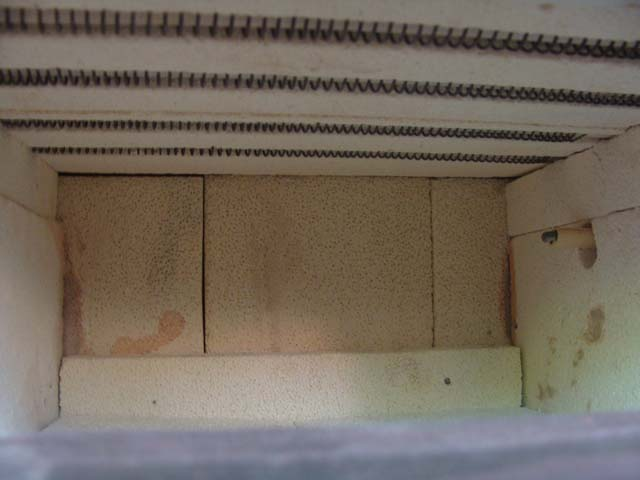 Here is some pics of my kiln. As I've said, it looks terrible, but it works!